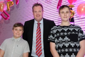 Ben Clarkson and Scott Reeve are presented with their finalists award for Invincible Carer by Mark Huby at the Doncaster Free Press Superkids.