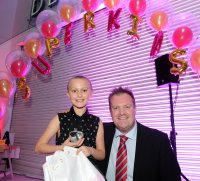 Casey Pearson is presented with her winners award for Invincible Carer by Mark Huby at the Doncaster Free Press Superkids.