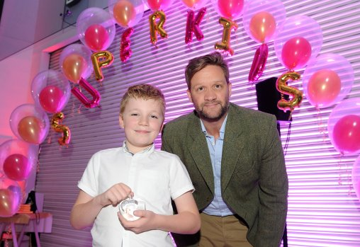 Harry Moxon is presented the winners award for Technology Whizz by Amazon at the Doncaster Free Press Superkids.