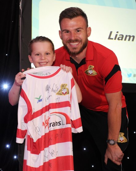 Andy Butler presents Liam Morrison with a Doncaster Rovers shirt at the Doncaster Free Press Superkids.