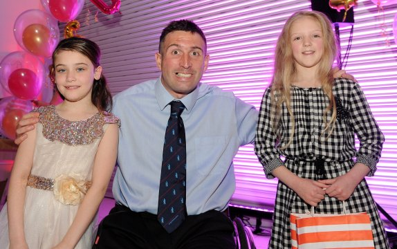 Poppy Cliff and Maisy Willis are presented with the joint 2nd place award for Mighty Performer by Ben Parkinson at the Doncaster Free Press Superkids.