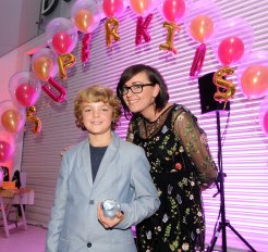 Toby Hopson is presented with the winner award for Wonder Writer by Natalie Collins at the Doncaster Free Press Superkids.